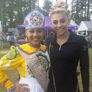 Junior Miss Lumbee Kaloni Skye Walton and Olympic gymnast Ashton Locklear pose for a picture at the Lumbee Homecoming Pow Wow at the University of North Carolina Pembroke. Photo courtesy of Jackie Jacobs