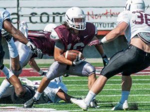 #16 Jerry Louie-McGhee ( Coeur d' Alene Tribe) running after his catch at the Griz scrimmage this weekend.
